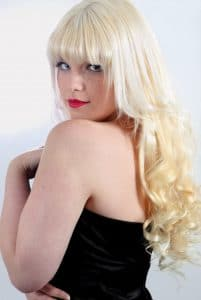 Model wearing clip in fringe hair extensions