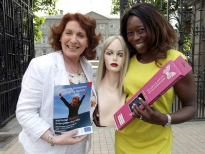 Yinka talks wigs with Minister Kathleen Lynch at Leinster House